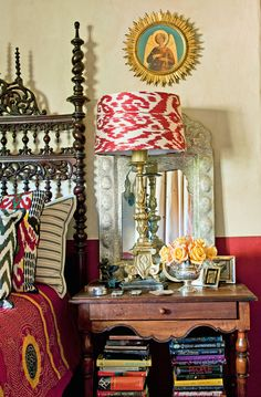 Gorgeous and eclectic bedroom. I love the multilayered color and decor!