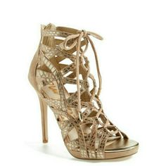 """Sam Edelman metallic snakeskin lace up heels Brand new! Comes with box.  Lace up caged heel. Snake embossed leather and suede. Nude and gold.  Back zipper closure.  5"""" heel / 1/2"""" platform. Sam Edelman Shoes Heels"""
