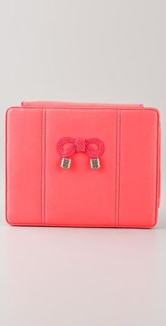 See by Chloe iPad cover in electric rose $125. We have 2 MacBook Pros and I have no interest in an iPad but this is super cute!