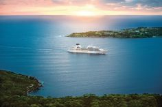 Seabourn Sojourn #cruise ship sits in a tranquil bay, the sun setting behind her and adventures set ahead... Find out more at http://the-cruise-specialists.co.uk/c/line-display/?cruiseline=Seabourn&client=the-cruise-specialists&nLin=29