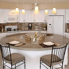 Bianco Modena Granite Countertops by Granite Transformations paired with Evolution Mosaic Tiles