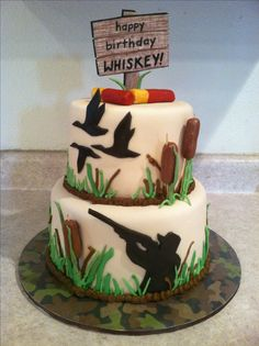 Duck hunting silhouette tier cake. Camo-colored marble cake inside, buttercream and marshmallow fondant.