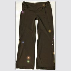 Lululemon Chocolate Brown Wide Leg Pants Lululemon Althetica Chocolate Brown Wide Leg Pants. Wide waistband with cinched ties to lower the rise or roll down. Flat seams and a straight leg flatter all figures. Size: 12. Body: 87% Nylon, 13% Lycra Spandex.  These pants are in excellent condition with no pilling, no holes, and all seams are in tact. lululemon athletica Pants Wide Leg