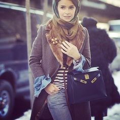 Again, when it comes to winter styling, Miroslava Duma can do no wrong. The interplay between the mink fur collar, the structured bag, casual jeans and striped tee is genius.