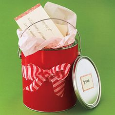 Unique Holiday Gift-Wrap Ideas: Can Do -Make a gift card more personal by tailoring the wrap to the item. Here, a home-store certificate nestles in a prettied-up paint can. For a manicure, use a cosmetics bag; for DVDs, try a popcorn box. Cute Gift Wrapping Ideas, Creative Gift Wrapping, Christmas Gift Wrapping, Creative Gifts, Gift Ideas, Wrapping Gifts, Christmas Ideas, Gift Wraping, Christmas Design