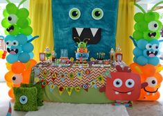 Cute little colorful monsters everywhere!! Birthday party idea for children.