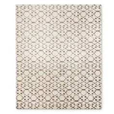 Tickle your toes in the soft pile of the Patterned Shag Woven Area Rug - Nate Berkus. The beautiful neutral colors and modern style complement any décor as the rug adds texture and a graphic motif. A perfect accent for any room in the house.