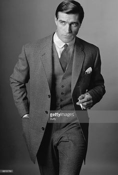 A male model poses in a three-piece suit, circa 1960. A fashion shoot for Town magazine.  Photo by Duffy