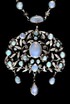 An Arts & Crafts silver and opal pendant, by Georgie Gaskin, ca.1918, Birmingham, England.