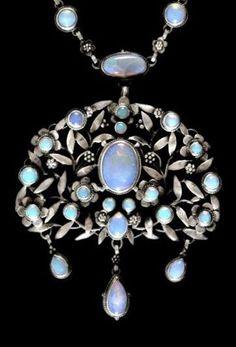 An Arts & Crafts silver and opal pendant, by Georgie Gaskin, ca.1918, Birmingham, England.