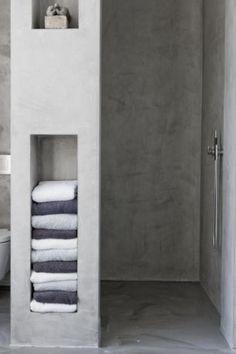 built in storage. concrete shower.