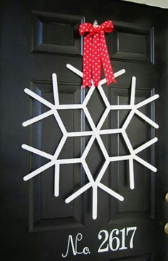 Popsicle stick wreath: These are light weight enough to be hung in a window on suction cup hooks.