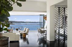 open herringbone wood screen/divider   --  Sydney Harbor Penthouse by Sarah Davison