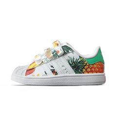Mini adidas Superstar's with a pineapple pattern.