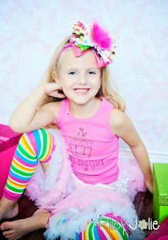 This Sassy Birthday Girl rhinestone bling shirt by If The Bow Fits is perfect for any birthday celebration. This birthday girl shirt features a cupcake and is very sparkly.     The neckline is trimmed with colorful bling stones.     Headband not included $30.00