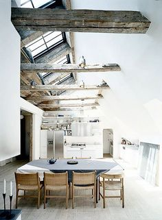 Love this space. Open, natural light, modern lines, but warm with the rough and natural textures of the timber and wood floors.