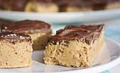 reese's peanut butter bars  Ingredients  1 1/2 cups graham cracker crumbs (I plan on trying Rice Krispies next time)  1 lb powdered sugar (3 to 3 1/2 cups)  1 1/2 cups peanut butter  1 cup butter, melted  1 (12 ounce) bag milk chocolate chips