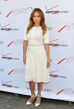 At the opening of her Viva Movil by Jennifer Lopez flagship store in New York on July 26, 2013.  AFP/Getty Images -Cosmopolitan.com