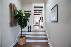 Episode 04 - The Big Country House - Magnolia Market.... hallway beams on ceiling