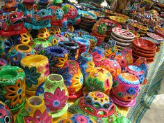 Pottery!  Tell me, where is this market?  I love the bright colors & designs!