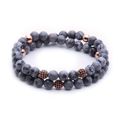 The Atolyestone Double beaded bracelet collection allows the convergence of grey jasper semi precious stones with cubic zirconia diamond balls with rose gold plating. These charm bracelets are made lengthier to permit a double loop around the bearer's wrist. All of our bracelets for men are 100% handmade jewelry made in our personal Atolyestone ateliers 6mm Grey Jasper 0.7mm Black String This Product Comes in an iconic Atolyestone square box If the item is out of stock, it will be shipped…