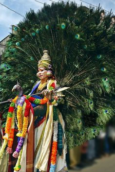 Peacock Man !  Onam in Kerala by Anoop Negi. This is Lord Subramanayam,son of Shiva, who is worshiped in South India as Murugan. This is a Festival, the season of Happiness.
