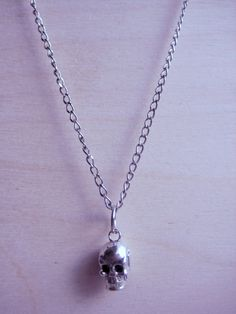 Cute silver skull pendant hung with silver chain and joined with lobster clasp. Necklace Measures: 10 inches Jewelry ships in protective bubble envelope. Skull Necklace, Pendant Necklace, Skull Pendant, Bubble Envelopes, Buy And Sell, Necklaces, Chain, Silver, Handmade