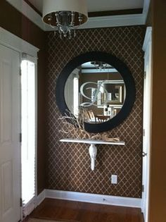 Cool entry idea. Love the wall stencil and monogrammed mirror. (or end of the hallway idea!)