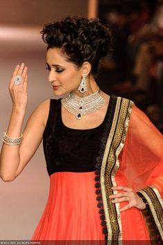 A model walks the ramp for jewellery brand Charu Jewels during the India International Jewellery Week (IIJW), held at Grand Hyatt, Mumbai, on August 06, 2013.