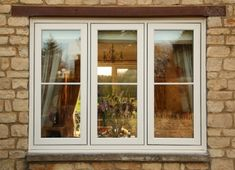 Traditional Look UPVc Windows and Doors Cottage Windows, Cottage Door, House Windows, Wood Cottage, Front Windows, Casement Windows, Windows And Doors, Upvc Sash Windows, Exterior Windows