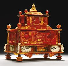CASKET, Attributed to Michel Redlin and Workshop, Gdańsk, Poland, ca 1680-90, red and yellow amber, ivory, mastic and mica, around a wood core 28.5 by 25.5cm., 11¼ by 10in. (TREASURES INCLUDING SELECTED WORKS FROM THE COLLECTIONS OF THE DUKES OF NORTHUMBERLAND)
