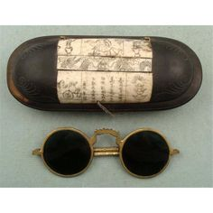Antique Chinese sunglasses, beautiful carved wooded case w/ inlays probably taken from something that was itself an antique at the time case was made.