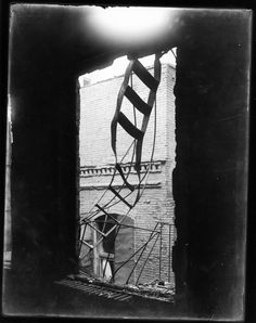 Photograph of a Broken Fire Escape after the Triangle Shirtwaist Factory Fire, 03/25/1911. 146 people (mostly women) died in just 18 minutes due to lack of water to fight the flames, locked doors, and fire truck ladders that were too short to reach the higher floors. In the aftermath, labor laws and workplace safety standards were heavily revamped.