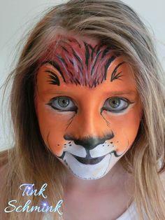 Lion face paint by Tink Schmink