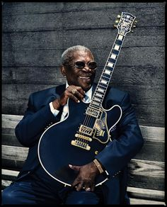 BB KIng, singer of  the Blues, dressed in blue, making his own beautiful music like the Bluebird.
