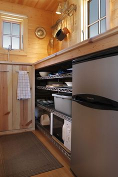 Small Kitchen Design:   A great way to save time and money, the commercial kitchen shelving was put underneath the finished wood countertop. These shelves can be found at stores like Ikea and Costco.