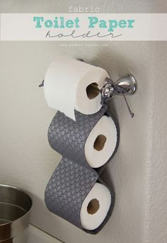 This DIY fabric toilet paper holder would be great for the households with people who refuse to replace the empty roll with a new one. Just make sure the holder is always filled and you're always prepared. http://hative.com/clever-toilet-paper-storage-or-holder-ideas/