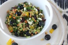 An easy, vibrantly delicious salad featuring kale, blueberries, dried cranberries, walnuts and feta. Perfect with freekeh or quinoa ... super healthy, too!