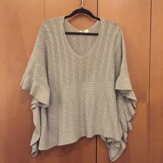 """Grey Poncho by Moth- Size M/L Grey Poncho by Moth- Size M/L from Anthropologie. 25"""" long. Sides are tacked to add some structure. Cascading sides. Cute worn over a tank with skinny jeans and tall boots. 47% wool; 44% cotton; 9% alpaca. Anthropologie Sweaters Shrugs & Ponchos"""