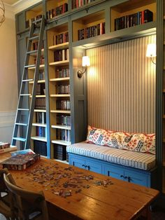 LOVE this! Bookshelves, lights, storage and a reading bench all on one wall :). Maybe when we really refinish the basement!