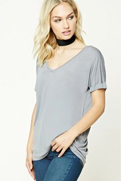 Forever 21 Contemporary - A slub knit top featuring a V-neckline, short cuffed dolman sleeves, and a longline silhouette.