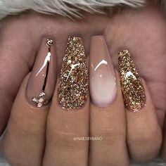 """REPOST - - - - Hazelnut-Brown Gold Glitter and Crystals on long Coffin Nails - - - - Picture and Nail Design by @nailsbybano Follow her for more gorgeous nail art designs! @nailsbybano @nailsbybano - - - - Products used: @jet_set_beauty_nails One Stroke Colour Gel """"Hazelnut"""" Glitter (custom mixed) Swarovski Crystals Striping Tape - - - -"""