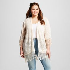 The Women's Plus Size Open Layering Top with Crotchet by Born Famous (Juniors') takes the convenience and function of a traditional cardigan and gives it a modern blast of style. This adorable top uses a variety of crocheted fabrics to create visual excitement with more than a touch of femininity. The looser, kimono cut with elbow sleeves adds an airy delight to any outfit.