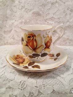Royal Albert Demitasse Tea Cup and Saucer. Very different, but I like the yellow and brown coloration.