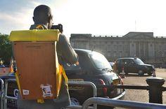 Woodsack XL Yellow Backpack. Taking photos outside Buckingham Palace London.