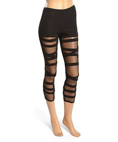 Update your casual-wear wardrobe with these edgy leggings boasting crisscross straps and mesh panels. Size note: This item runs small. Ordering one size up is recommended.