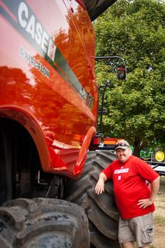 """Tractors get bigger and bigger, my husband is 6'4"""" he looks small. Take a trip through the best county fair in Nebraska"""