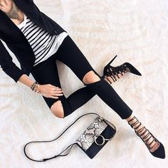 A black blazer, striped tee, skinny jeans, and sexy lace-up heels