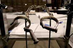A pair of slave shackles are on display in the Slavery and Freedom Gallery in the Smithsonian's National Museum of African American History and Culture during the press preview on the National Mall September 14, 2016 in Washington, DC.