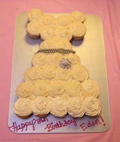 White baptism dress cupcake cake. Cute idea for an 8th birthday cake.